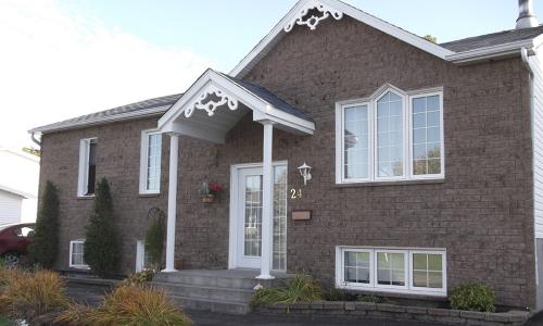Mortarless screw-on brick home